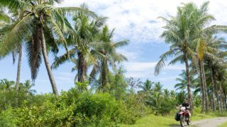 Motorcyclist with surfboard, Abulug, Cagayan, Philippines