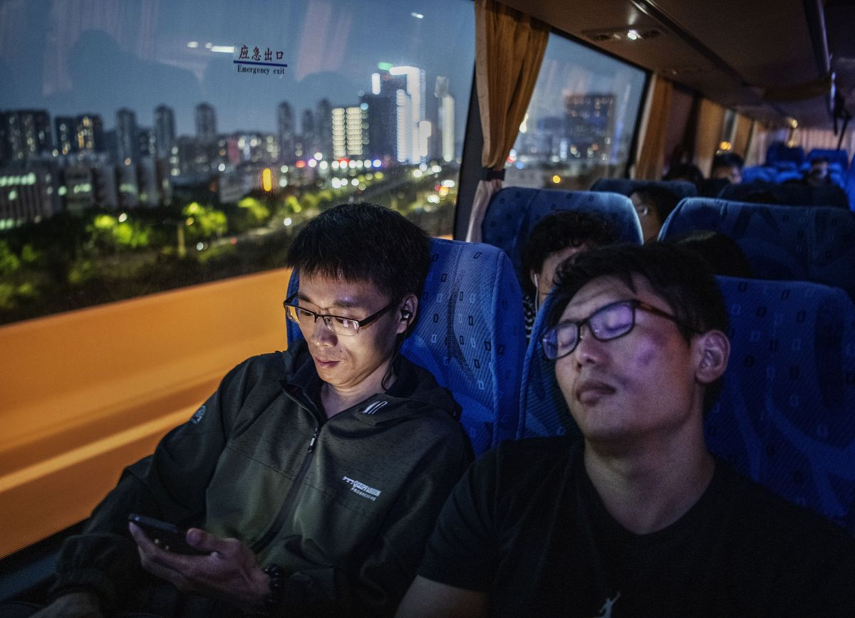 SHENZHEN, CHINA - APRIL 26: Huawei employees ride the bus home at the end of the workday from the company's Bantian campus on April 26, 2019 in Shenzhen, China. Huawei is Chinas most valuable technology brand, and sells more telecommunications equipment than any other company in the world, with annual revenue topping $100 billion U.S.  Headquartered in the southern city of Shenzhen, considered Chinas Silicon Valley, Huawei has more than 180,000 employees worldwide, with nearly half of them engaged in research and development. In 2018, the company overtook Apple Inc. as the second largest manufacturer of smartphones in the world behind Samsung Electronics, a milestone that has made Huawei a source of national pride in China.While commercially successful and a dominant player in 5G, or fifth-generation networking technology, Huawei has faced political headwinds and allegations that its equipment includes so-called backdoors that the U.S. government perceives as a national security. U.S. authorities are also seeking the extradition of Huaweis Chief Financial Officer, Meng Wanzhou, to stand trial in the U.S. on fraud charges. Meng is currently under house arrest in Canada, though Huawei maintains the U.S. case against her is purely political. Despite the U.S. campaign against the company, Huawei is determined to lead the global charge toward adopting 5G wireless networks.  It has hired experts from foreign rivals, and invested heavily in R&D to patent key technologies to boost Chinese influence.(Photo by Kevin Frayer/Getty Images)
