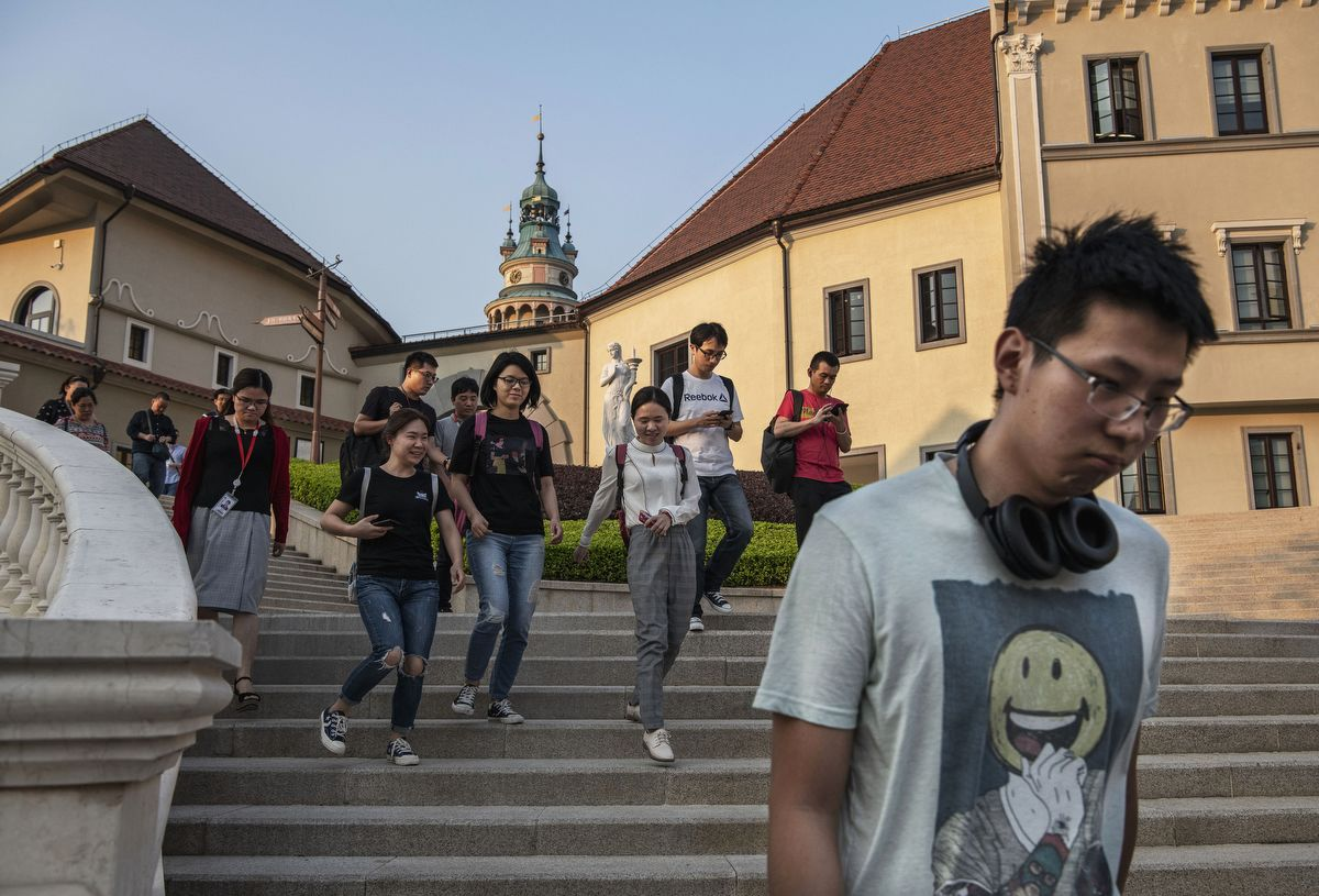 DONGGUAN, CHINA - APRIL 24: Huawei workers walk together at the end of their workday at the sprawling 'Ox Horn' Research and Development campus on April 24, 2019 in Dongguan, near Shenzhen, China. Huawei is Chinas most valuable technology brand, and sells more telecommunications equipment than any other company in the world, with annual revenue topping $100 billion U.S.  Headquartered in the southern city of Shenzhen, considered Chinas Silicon Valley, Huawei has more than 180,000 employees worldwide, with nearly half of them engaged in research and development. In 2018, the company overtook Apple Inc. as the second largest manufacturer of smartphones in the world behind Samsung Electronics, a milestone that has made Huawei a source of national pride in China.While commercially successful and a dominant player in 5G, or fifth-generation networking technology, Huawei has faced political headwinds and allegations that its equipment includes so-called backdoors that the U.S. government perceives as a national security. U.S. authorities are also seeking the extradition of Huaweis Chief Financial Officer, Meng Wanzhou, to stand trial in the U.S. on fraud charges. Meng is currently under house arrest in Canada, though Huawei maintains the U.S. case against her is purely political. Despite the U.S. campaign against the company, Huawei is determined to lead the global charge toward adopting 5G wireless networks.  It has hired experts from foreign rivals, and invested heavily in R&D to patent key technologies to boost Chinese influence.(Photo by Kevin Frayer/Getty Images)