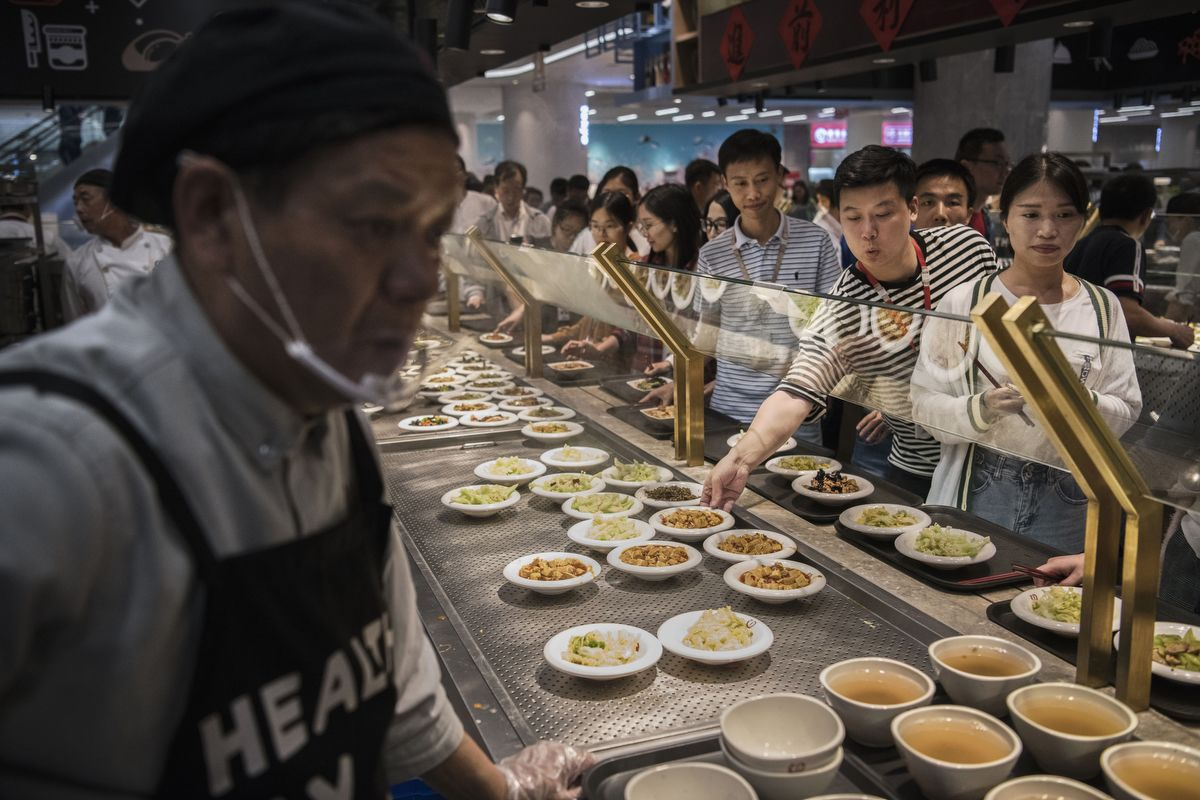 SHENZHEN, CHINA - APRIL 12: Huawei employees wait in line for lunch at a subsidized cafeteria at the company's Bantian campus on April 12, 2019 in Shenzhen, China. Huawei is Chinas most valuable technology brand, and sells more telecommunications equipment than any other company in the world, with annual revenue topping $100 billion U.S.  Headquartered in the southern city of Shenzhen, considered Chinas Silicon Valley, Huawei has more than 180,000 employees worldwide, with nearly half of them engaged in research and development. In 2018, the company overtook Apple Inc. as the second largest manufacturer of smartphones in the world behind Samsung Electronics, a milestone that has made Huawei a source of national pride in China.While commercially successful and a dominant player in 5G, or fifth-generation networking technology, Huawei has faced political headwinds and allegations that its equipment includes so-called backdoors that the U.S. government perceives as a national security. U.S. authorities are also seeking the extradition of Huaweis Chief Financial Officer, Meng Wanzhou, to stand trial in the U.S. on fraud charges. Meng is currently under house arrest in Canada, though Huawei maintains the U.S. case against her is purely political. Despite the U.S. campaign against the company, Huawei is determined to lead the global charge toward adopting 5G wireless networks.  It has hired experts from foreign rivals, and invested heavily in R&D to patent key technologies to boost Chinese influence. (Photo by Kevin Frayer/Getty Images)