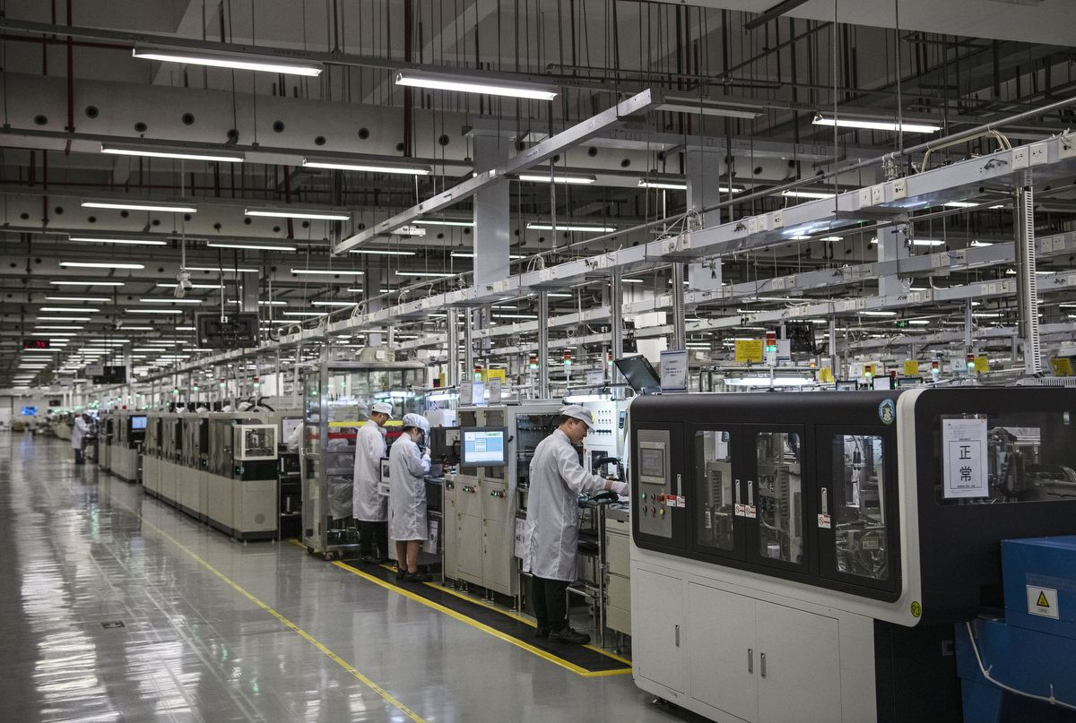 DONGGUAN, CHINA - APRIL 11: Workers are seen on the production line at Huawei's production campus on April 11, 2019 in Dongguan, near Shenzhen, China. Huawei is Chinas most valuable technology brand, and sells more telecommunications equipment than any other company in the world, with annual revenue topping $100 billion U.S.  Headquartered in the southern city of Shenzhen, considered Chinas Silicon Valley, Huawei has more than 180,000 employees worldwide, with nearly half of them engaged in research and development. In 2018, the company overtook Apple Inc. as the second largest manufacturer of smartphones in the world behind Samsung Electronics, a milestone that has made Huawei a source of national pride in China.While commercially successful and a dominant player in 5G, or fifth-generation networking technology, Huawei has faced political headwinds and allegations that its equipment includes so-called backdoors that the U.S. government perceives as a national security. U.S. authorities are also seeking the extradition of Huaweis Chief Financial Officer, Meng Wanzhou, to stand trial in the U.S. on fraud charges. Meng is currently under house arrest in Canada, though Huawei maintains the U.S. case against her is purely political. Despite the U.S. campaign against the company, Huawei is determined to lead the global charge toward adopting 5G wireless networks.  It has hired experts from foreign rivals, and invested heavily in R&D to patent key technologies to boost Chinese influence.(Photo by Kevin Frayer/Getty Images)