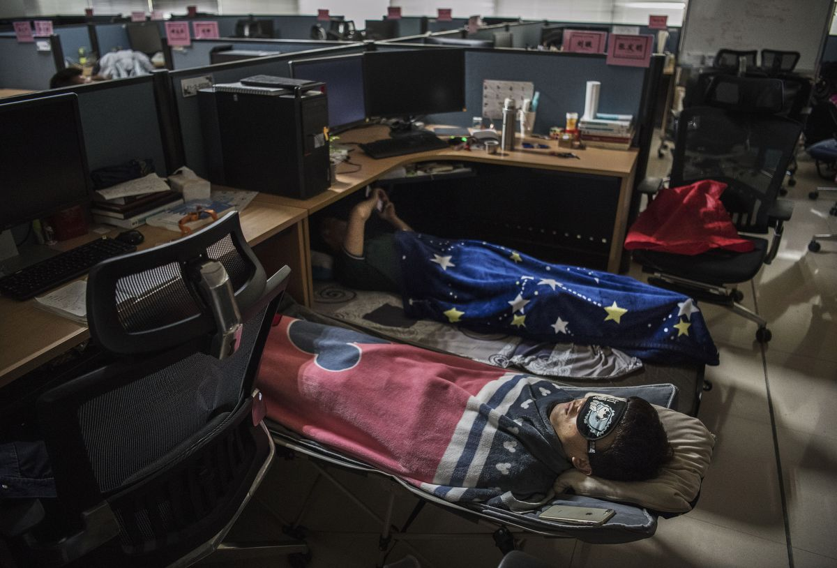 SHENZHEN, CHINA - APRIL 12: Huawei employees sleep at their cubicle during their lunch break, which is known to be common practice in many workplaces in China, at the research and development area in the Bantian campus on April 12, 2019, in Shenzhen, China. Huawei is Chinas most valuable technology brand, and sells more telecommunications equipment than any other company in the world, with annual revenue topping $100 billion U.S.  Headquartered in the southern city of Shenzhen, considered Chinas Silicon Valley, Huawei has more than 180,000 employees worldwide, with nearly half of them engaged in research and development. In 2018, the company overtook Apple Inc. as the second largest manufacturer of smartphones in the world behind Samsung Electronics, a milestone that has made Huawei a source of national pride in China.While commercially successful and a dominant player in 5G, or fifth-generation networking technology, Huawei has faced political headwinds and allegations that its equipment includes so-called backdoors that the U.S. government perceives as a national security. U.S. authorities are also seeking the extradition of Huaweis Chief Financial Officer, Meng Wanzhou, to stand trial in the U.S. on fraud charges. Meng is currently under house arrest in Canada, though Huawei maintains the U.S. case against her is purely political. Despite the U.S. campaign against the company, Huawei is determined to lead the global charge toward adopting 5G wireless networks.  It has hired experts from foreign rivals, and invested heavily in R&D to patent key technologies to boost Chinese influence. (Photo by Kevin Frayer/Getty Images)
