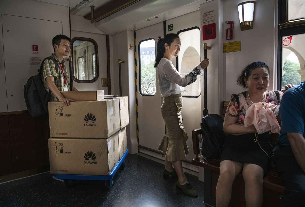 DONGGUAN, CHINA - APRIL 24: A Huawei worker moves boxes on a train used by employees, clients and visitors at the new sprawling 'Ox Horn' Research and Development campus on April 24, 2019 in Dongguan, near Shenzhen, China.Huawei is Chinas most valuable technology brand, and sells more telecommunications equipment than any other company in the world, with annual revenue topping $100 billion U.S.  Headquartered in the southern city of Shenzhen, considered Chinas Silicon Valley, Huawei has more than 180,000 employees worldwide, with nearly half of them engaged in research and development. In 2018, the company overtook Apple Inc. as the second largest manufacturer of smartphones in the world behind Samsung Electronics, a milestone that has made Huawei a source of national pride in China.While commercially successful and a dominant player in 5G, or fifth-generation networking technology, Huawei has faced political headwinds and allegations that its equipment includes so-called backdoors that the U.S. government perceives as a national security. U.S. authorities are also seeking the extradition of Huaweis Chief Financial Officer, Meng Wanzhou, to stand trial in the U.S. on fraud charges. Meng is currently under house arrest in Canada, though Huawei maintains the U.S. case against her is purely political. Despite the U.S. campaign against the company, Huawei is determined to lead the global charge toward adopting 5G wireless networks.  It has hired experts from foreign rivals, and invested heavily in R&D to patent key technologies to boost Chinese influence. (Photo by Kevin Frayer/Getty Images)