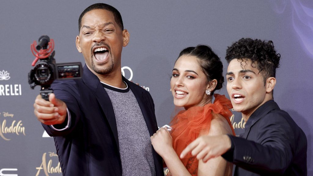 """BERLIN, GERMANY - MAY 11: US actor and singer Will Smith, British actress and singer Naomi Scott and Canadian actor Mena Massoud  attend the movie premiere of """"Aladdin"""" at UCI Luxe Mercedes Platz on May 11, 2019 in Berlin, Germany. (Photo by Isa Foltin/WireImage)"""
