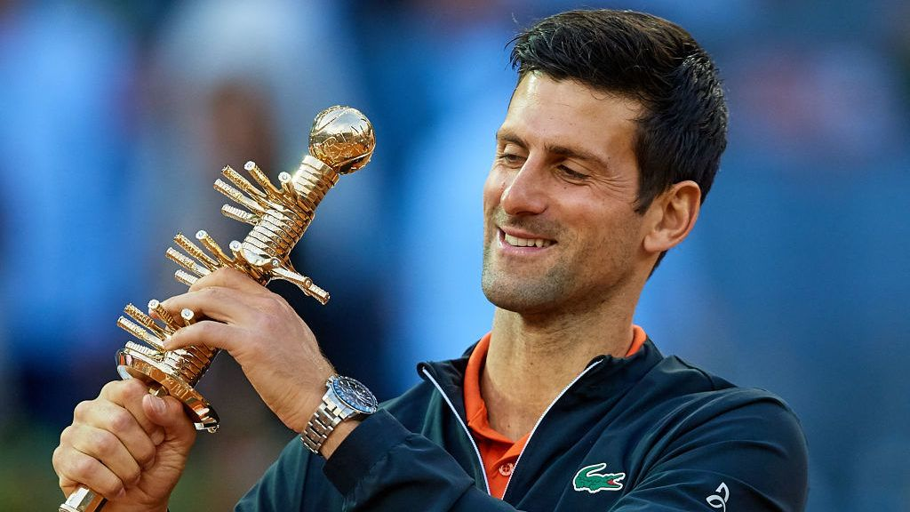 MADRID, SPAIN - MAY 12: Novak Djokovic of Serbia celebrates the victory as he holds the winners trophy following the men's singles final against Stefano Tsitsipas of Greece  during day 9 of the Mutua Madrid Open at La Caja Magica on May 12, 2019 in Madrid, Spain. (Photo by David Aliaga/MB Media/Getty Images)