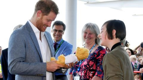 OXFORD, ENGLAND - MAY 13: Prince Harry, Duke of Sussex receives a gift from former patient Daisy Wingrove, aged 13 as he arrives for a visit to the Oxford Children's Hospital on May 14, 2019 in Oxford, England. (Photo by Toby Melville  - WPA Pool/Getty Images)