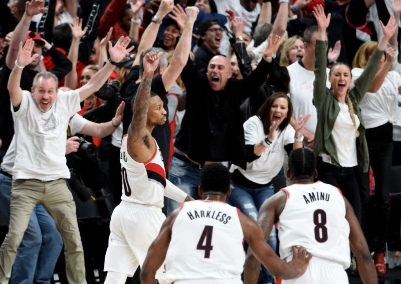 PORTLAND, OREGON - APRIL 23: Damian Lillard #0 of the Portland Trail Blazers reacts after hitting the game winning shot in Game Five of the Western Conference quarterfinals against the Oklahoma City Thunder during the 2019 NBA Playoffs at Moda Center on April 23, 2019 in Portland, Oregon. The Blazers won 118-115.  NOTE TO USER: User expressly acknowledges and agrees that, by downloading and or using this photograph, User is consenting to the terms and conditions of the Getty Images License Agreement. (Photo by Steve Dykes/Getty Images)   (Photo by Steve Dykes/Getty Images)