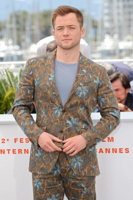 """CANNES, FRANCE - MAY 16: Taron Egerton attends the photocall for """"Rocketman"""" during the 72nd annual Cannes Film Festival on May 16, 2019 in Cannes, France. (Photo by Eamonn M. McCormack/Getty Images)"""