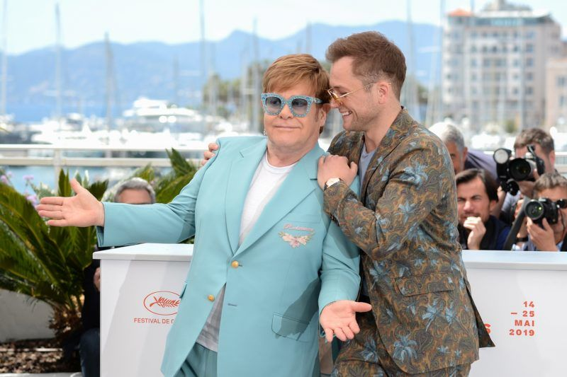 """CANNES, FRANCE - MAY 16: Sir Elton John and Taron Egerton attend the photocall for """"Rocketman"""" during the 72nd annual Cannes Film Festival on May 16, 2019 in Cannes, France. (Photo by Eamonn M. McCormack/Getty Images)"""