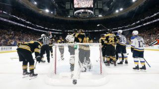 BOSTON, MASSACHUSETTS - MAY 27:  Tuukka Rask #40 of the Boston Bruins is congratulated by his teammates after their 4-2 win over the St. Louis Blues in Game One of the 2019 NHL Stanley Cup Final at TD Garden on May 27, 2019 in Boston, Massachusetts. (Photo by Patrick Smith/Getty Images)