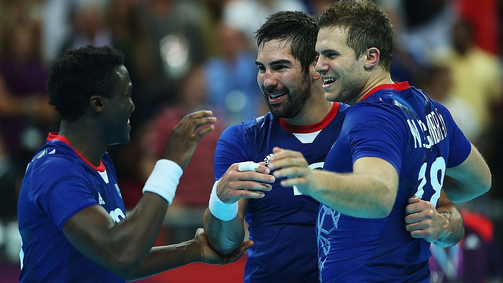 LONDON, ENGLAND - AUGUST 10:  (L-R) Luc Abalo #19, Nikola Karabatic #13 and William Accambray #18 of France celebrate their teams victory over Croatia during the Men's Handball semifinal game between France and Croatia on Day 14 of the London 2012 Olympic Games at the Basketball Arena on August 10, 2012 in London, England.  (Photo by Jeff Gross/Getty Images)