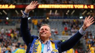 MANNHEIM, GERMANY - MARCH 31:  Kielce president Bertus Servaas waves prior to the Velux EHF Champions League Round of 16 second leg match between Rhein-Neckar Loewen and KS Vieve Kielce at SAP Arena on March 31, 2014 in Mannheim, Germany.  (Photo by Alex Grimm/Bongarts/Getty Images)