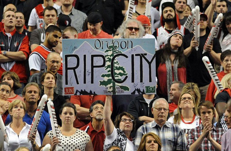 PORTLAND, OR - MAY 2: Portland Trail Blazers fans hold up a 'Rip City' sign in the fourth quarter of Game Six of the Western Conference Quarterfinals against the Houston Rocketsduring the 2014 NBA Playoffs at the Moda Center on May 2, 2014 in Portland, Oregon. NOTE TO USER: User expressly acknowledges and agrees that, by downloading and or using this photograph, User is consenting to the terms and conditions of the Getty Images License Agreement. (Photo by Steve Dykes/Getty Images)