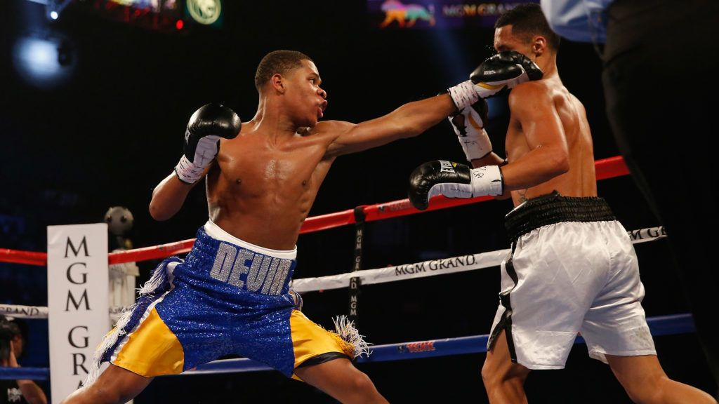 LAS VEGAS, NEVADA - APRIL 09:  Devin Haney (L) throws a left at Rafael Vazquez during their super featherweight fight on April 9, 2016 at MGM Grand Garden Arena in Las Vegas, Nevada.  (Photo by Christian Petersen/Getty Images)