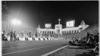 Performers stand ready along the track in the Los Angeles Coliseum on the night of the opening ceremonies for the 1984 Summer Olympic Games. Many communist nations boycotted the Games that year, notably the USSR, East Germany, and Cuba, as retaliation for the US-led boycott of the 1980 Summer Games in Moscow.   (Photo by David Turnley/Corbis/VCG via Getty Images)