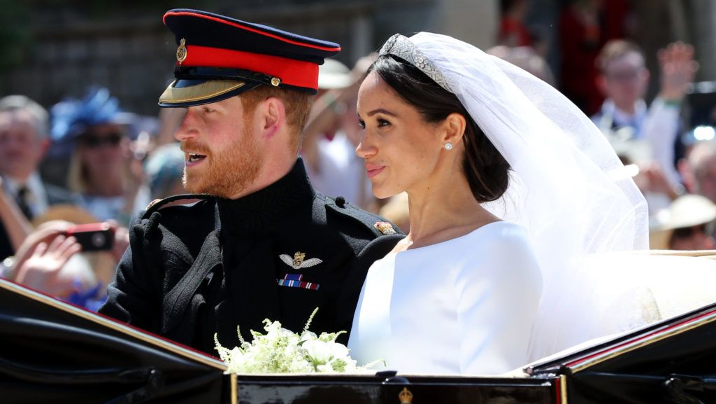 WINDSOR, ENGLAND - MAY 19:  Prince Harry, Duke of Sussex and The Duchess of Sussex leave Windsor Castle in the Ascot Landau carriage during a procession after getting married at St Georges Chapel on May 19, 2018 in Windsor, England. Prince Henry Charles Albert David of Wales marries Ms. Meghan Markle in a service at St George's Chapel inside the grounds of Windsor Castle. Among the guests were 2200 members of the public, the royal family and Ms. Markle's Mother Doria Ragland. (Photo by Gareth Fuller - WPA/Getty Images)