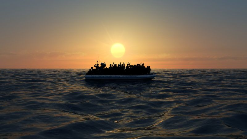 Refugees on a big rubber boat in the middle of the sea that require help. Sea with people in the water asking for help. Migrants crossing the sea
