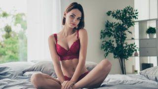Portrait of nice cute delicate gorgeous stunning feminine lovely sweet attractive girlish  girl sitting on bed linen resting in modern light white interior room