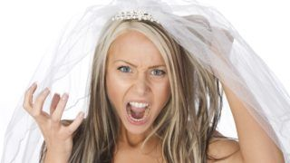 young angry bride as a bridezilla or stressful wedding planning concept, isolated on white background