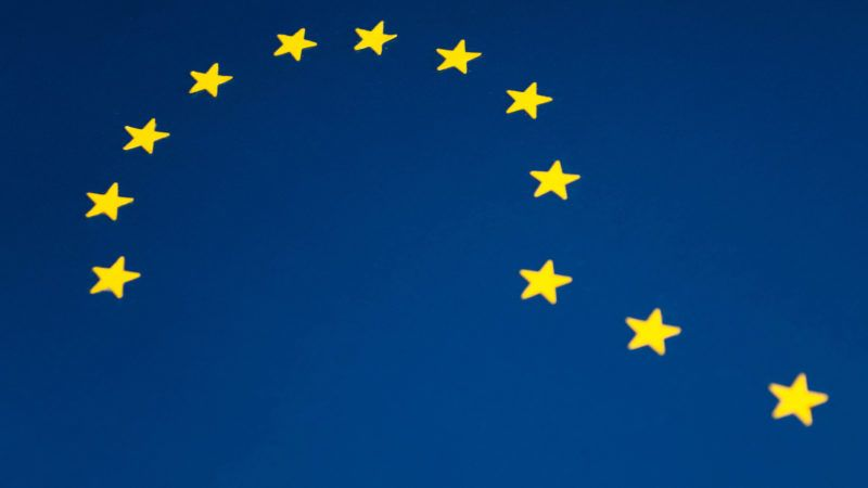 A question mark shaped with the yellow stars of the European Flag.
