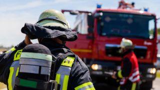 german fireman ( Feuerwehr ) stands near an accident