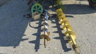 Augers on the floor. Details of the combine. Unloading auger.