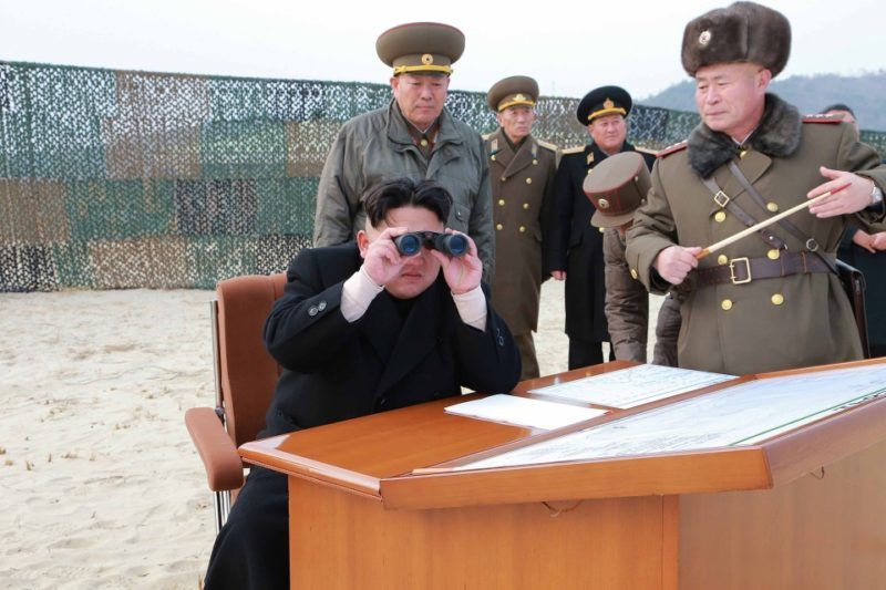 """This undated photo released by North Korea's official Korean Central News Agency (KCNA) on December 30, 2014 shows North Korean leader Kim Jong-Un (C) visiting the multiple-rocket launching drill of women's sub-units under the Korean People's Army Unit 851 at an undisclosed location.   REPUBLIC OF KOREA OUT AFP PHOTO / KCNA via KNS THIS PICTURE WAS MADE AVAILABLE BY A THIRD PARTY. AFP CAN NOT INDEPENDENTLY VERIFY THE AUTHENTICITY, LOCATION, DATE AND CONTENT OF THIS IMAGE. THIS PHOTO IS DISTRIBUTED EXACTLY AS RECEIVED BY AFP. ---EDITORS NOTE--- RESTRICTED TO EDITORIAL USE - MANDATORY CREDIT """"AFP PHOTO/KCNA VIA KNS"""" - NO MARKETING NO ADVERTISING CAMPAIGNS - DISTRIBUTED AS A SERVICE TO CLIENTS"""