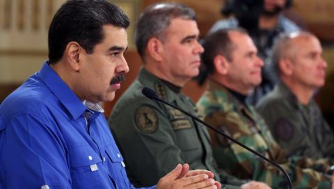 """Handout photo released by the Venezuelan Presidency of Venezuela's President Nicolas Maduro (L) next to Venezuelan Defence Minister Vladimir Padrino (C) and the chief of the Estrategic Operations Command of the Bolivarian National Armed Forces (CEOFANB) Remigio Ceballos delivering a message at the Miraflores presidential palace in Caracas, on April 30, 2019. - Maduro denied Tuesday claims by US Secretary of State Mike Pompeo that he had intended to flee to Cuba in the midst of a military uprising against him. (Photo by HO / Venezuelan Presidency / AFP) / RESTRICTED TO EDITORIAL USE - MANDATORY CREDIT """"AFP PHOTO / VENEZUELAN PRESIDENCY"""" - NO MARKETING NO ADVERTISING CAMPAIGNS - DISTRIBUTED AS A SERVICE TO CLIENTS"""