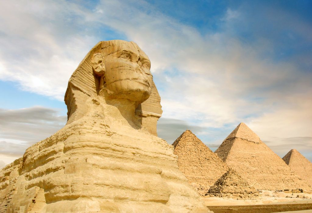 Famouse Sphinx and the great pyramids under interesting evening clouds, Cairo, Egypt