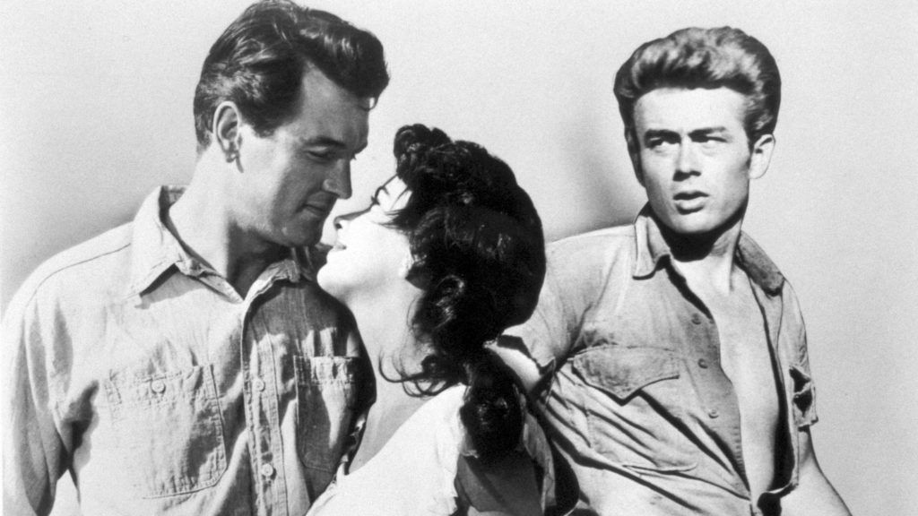 Apr 03, 1965; Hollywood, CA, USA; Actors ROCK HUDSON as Jordan 'Bick' Benedict, ELIZABETH TAYLOR as Lesllie Lynnton Benedict and JAMES DEAN as Jett Rink star in the drama 'Giant' directed by George Stevens.Mandatory Credit: Photo by Warner Bros./ZUMA Press.(©) Copyright 1965 by Courtesy of Warner Bros.