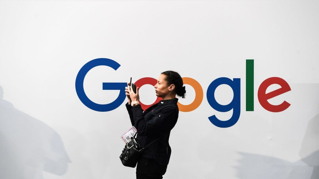 (FILES) In this file photo taken on May 16, 2019, a woman takes a picture with two smartphones in front of the logo of the US multinational technology and Internet-related services company Google as he visits the Vivatech startups and innovation fair, in Paris. - The US administration is stepping up scrutiny of Big Tech firms, which could result in a series of drawn-out legal battles aimed at reining in -- and potentially breaking up -- giants such as Google, Amazon and Facebook. The Department of Justice and Federal Trade Commission have carved out territory for the investigations to set the stage for reviews of the dominance of the largest of the Silicon Valley firms, media reports said on June 3, 2019. (Photo by ALAIN JOCARD / AFP)