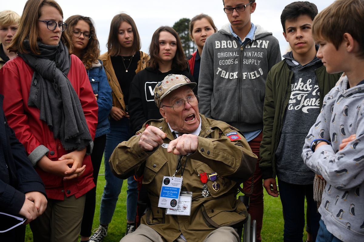 WWII US veteran George Shenkle chats with young students after a remembrance ceremony at The Normandy American Cemetery in Colleville-sur-Mer on June 4, 2019, ahead of the 75th anniversary of D-Day. -  (Photo by Damien MEYER / AFP)