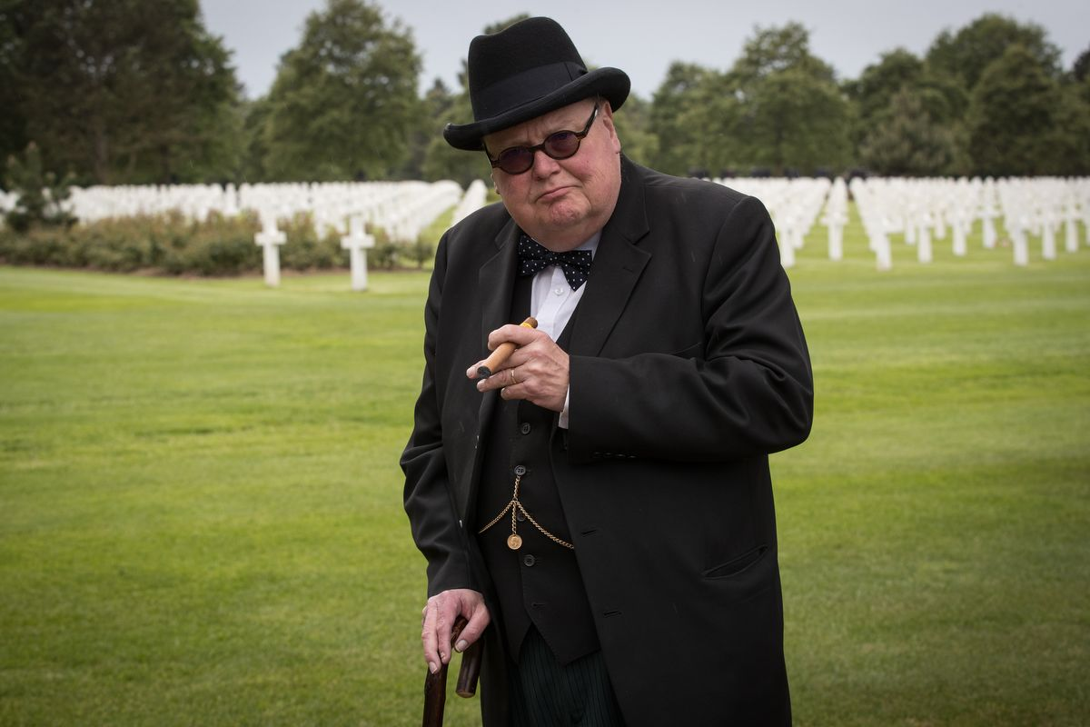 A double of Winston Churchill attends at The Normandy American Cemetery, close to Omaha Beach, in Colleville-sur-Mer, on June 4, 2019 as part of events for the 75th anniversary of D-Day. (Photo by JOEL SAGET / AFP)
