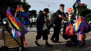 A vendor stop on Pennsylvania Avenue in front of the White House while walking to the DC Gay Pride Parade on June 8, 2019, in Washington, DC. (Photo by Brendan Smialowski / AFP)