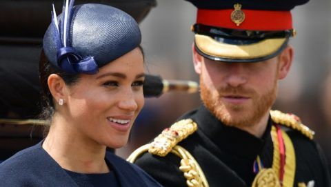 Britain's Meghan, Duchess of Sussex (L) and Britain's Prince Harry, Duke of Sussex (R) return to Buckingham Palace after the Queen's Birthday Parade, 'Trooping the Colour', in London on June 8, 2019. - The ceremony of Trooping the Colour is believed to have first been performed during the reign of King Charles II. Since 1748, the Trooping of the Colour has marked the official birthday of the British Sovereign. Over 1400 parading soldiers, almost 300 horses and 400 musicians take part in the event. (Photo by Daniel LEAL-OLIVAS / AFP)