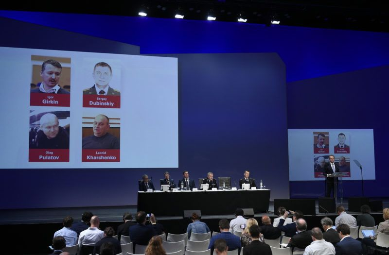 Dutch Police Head of Central Crime Investigation Department Wilbert Paulissen addresses next to the pictures of former FSB colonel Igor Girkin (from top to bottom), Sergei Dubinsky employed by Russia's GRU military intelligence agency, Oleg Pulatov former soldier of the Spetznaz GRU and Ukrainian Leonid Kharchenko, on June 19, 2019 in Nieuwegein during a press conference of the JIT on the ongoing investigation of the Malaysia Airlines MH17 crash in 2014. - The Dutch-led probe said it was going to prosecute Russian nationals Igor Girkin, Sergey Dubinsky and Oleg Pulatov as well as Ukrainian Leonid Kharchenko over the downing of the Malaysia Airlines plane. (Photo by JOHN THYS / AFP)