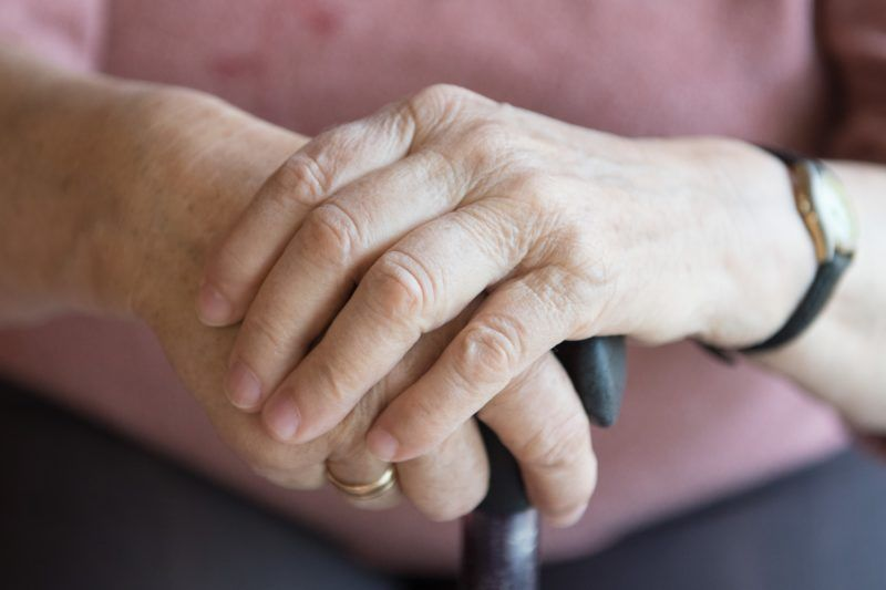 10 May 2019, Saxony, Bernsdorf: A woman's hands rest on a walking stick in a nursing home. Photo: Sebastian Kahnert/dpa-Zentralbild/dpa
