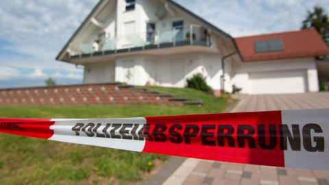 """03 June 2019, Hessen, Wolfhagen: Barrier tape with the inscription """"Police Barrier"""" can be seen in front of the house of the late Kassel District President Walter L¸bcke (CDU). L¸bcke died unexpectedly on the night of Sunday at the age of 65. Photo: Swen Pfˆrtner/dpa"""