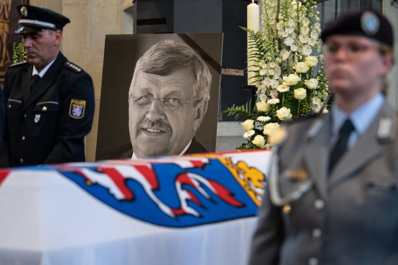 13 June 2019, Hessen, Kassel: The portrait of Walter Lübcke (CDU) can be seen behind a Bundeswehr soldier at the coffin during a funeral service in the Martinskirche. Lübcke was killed with a shot to the head on the terrace of his house. Photo: Swen Pförtner/dpa-POOL/dpa