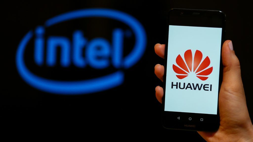 IZMIR, TURKEY - MAY 28: A person holds a Huawei mobile phone in front of logo of Intel in Izmir, Turkey on May 28, 2019. Emin Menguarslan / Anadolu Agency