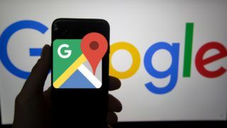 The logo of Google Maps is seen on a screen. In the background there is the logo of Google. Alphabet is the mother company of Google. It has a revenue of 117 billion dollars. (Photo by Alexander Pohl/NurPhoto)