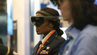 Attendees wear googles while participating in an Augmented Reality demonstration hosted by US defense contractor Raytheon during the 35th Space Symposium at The Broadmoor in Colorado Springs, Colorado on April 9, 2019. - NASA is preparing to use the SLS rocket to send US astronauts to the moon in 2024. The four day symposium is the largest space trade show in the world, attracting leaders focusing on space technology, satellite development, rocket design, and space policy. (Photo by Jason Connolly / AFP)