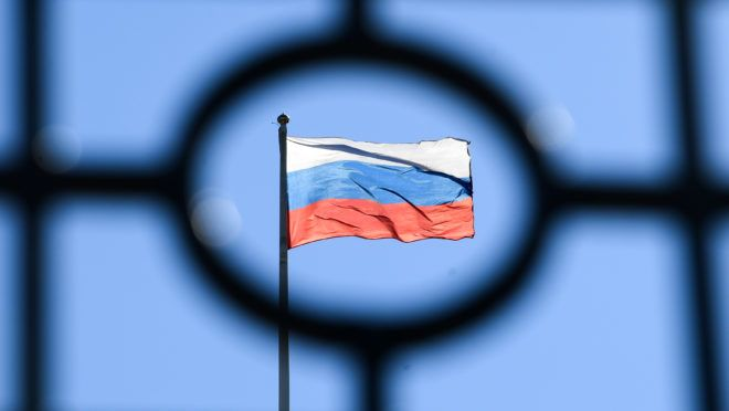 A Russian flag is seen at the top of the Moscow City Court building in Moscow on April 15, 2019, a day before the court is due to deliver verdict against 63-year-old Norwegian Frode Berg on spy charges. (Photo by Kirill KUDRYAVTSEV / AFP)