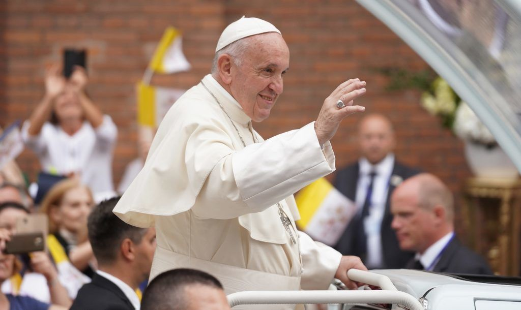 Pope Francis waves as he arrives in the Popemobile at the Saint Joseph Cathedral in Bucharest on May 31, 2019. - Pope Francis came to Romania with a message of integration not just for its faith communities but for a post-election European Union, following nationalist gains. During the three-day trip to the mainly Orthodox country, which sits at the crossroads of Western and Eastern Europe, Francis is expected to touch on issues fuelling nationalism, such as poverty, as well as inter-religious relations. (Photo by Andrei PUNGOVSCHI / AFP)