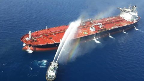 """(FILES) In this file picture obtained by AFP from Iranian news agency Tasnim on June 13, 2019 reportedly shows an Iranian navy boat trying to control fire from Norwegian owned Front Altair tanker said to have been attacked in the waters of the Gulf of Oman. - President Donald Trump downplayed recent attacks on oil tankers in the Gulf of Oman that Washington blames on Iran and noted that the United States is less dependent on energy supplies from the region.""""So far, it's been very minor,"""" Trump told Time magazine in an interview released June 17, 2019. However, Trump said he accepts the US intelligence assessment that Iran is behind the explosions that damaged the hulls of Norwegian and Japanese tankers.""""I don't think too many people don't believe it,"""" he said. (Photo by - / TASNIM NEWS / AFP)"""