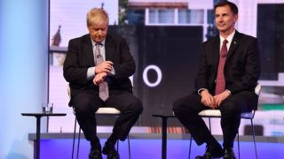 """In a handout picture released by the British Broadcasting Corperation (BBC) on June 18, 2019 Conservative Party leadership contender Conservative MP Boris Johnson (L) checks his watch seated next to Britain's Foreign Secretary Jeremy Hunt (R) during a BBC television leadership debate in London on June 18, 2019. - The UK leadership race narrowed to five in a second vote by MPs on June 18 with the remaining contenders taking part in a televised debate organised by the BBC. (Photo by JEFF OVERS / BBC / AFP) / RESTRICTED TO EDITORIAL USE - MANDATORY CREDIT """" AFP PHOTO / JEFF OVERS-BBC """" - NO MARKETING NO ADVERTISING CAMPAIGNS - DISTRIBUTED AS A SERVICE TO CLIENTS TO REPORT ON THE BBC PROGRAMME OR EVENT SPECIFIED IN THE CAPTION - NO ARCHIVE - NO USE AFTER  JULY 9, 2019 /"""