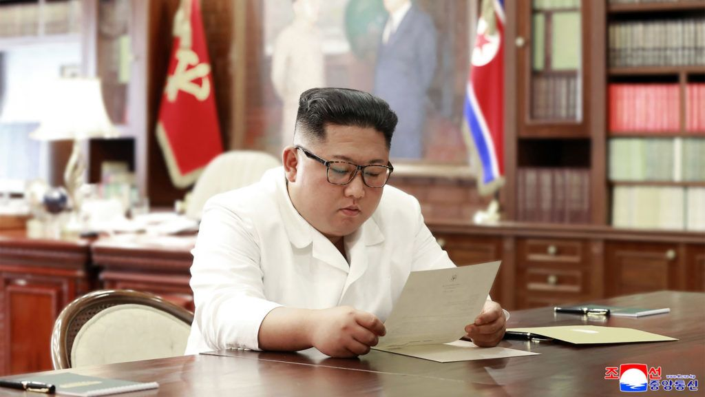 """(FILES) This file undated and unlocated picture released from North Korea's official Korean Central News Agency (KCNA)on June 23, 2019 shows North Korean leader Kim Jong Un reading a personal letter from President of the United States of America Donald Trump. - President Donald Trump said on June 24, 2019 that Kim Jong Un had wished him happy birthday in a letter received earlier this month amid a nuclear deadlock between the United States and North Korea.""""He actually sent me birthday wishes and it was a friendly letter,"""" Trump -- who turned 74 on June 14 -- told reporters in the Oval Office when questioned about the missive.His comments came a day after North Korean state media quoted Kim as saying he had received a letter of """"excellent content"""" from the US president. (Photo by KCNA VIA KNS / KCNA VIA KNS / AFP) / - South Korea OUT / ---EDITORS NOTE--- RESTRICTED TO EDITORIAL USE - MANDATORY CREDIT """"AFP PHOTO/KCNA VIA KNS"""" - NO MARKETING NO ADVERTISING CAMPAIGNS - DISTRIBUTED AS A SERVICE TO CLIENTS / THIS PICTURE WAS MADE AVAILABLE BY A THIRD PARTY. AFP CAN NOT INDEPENDENTLY VERIFY THE AUTHENTICITY, LOCATION, DATE AND CONTENT OF THIS IMAGE --- /"""
