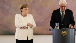 German Chancellor Angela Merkel attends a ceremony where the country's new Justice Minister was given her certificate of appointment by German President Frank-Walter Steinmeier at the presidential Bellevue Palace in Berlin on June 27, 2019. - During the ceremony, Merkel suffered a new shaking spell, just one week after sparking concerns by visibly trembling at another official ceremony. (Photo by Kay Nietfeld / dpa / AFP) / Germany OUT