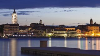 Old town of Rab town with Belfry of St. Justine's church, great bell tower of St. Mary's church, campanile of church of St. John and campanile of monastery of St. Andrew at dusk, Rab town, Rab Island, Kvarner region, Dalmatia, Adriatic Sea, Croatia, Europe