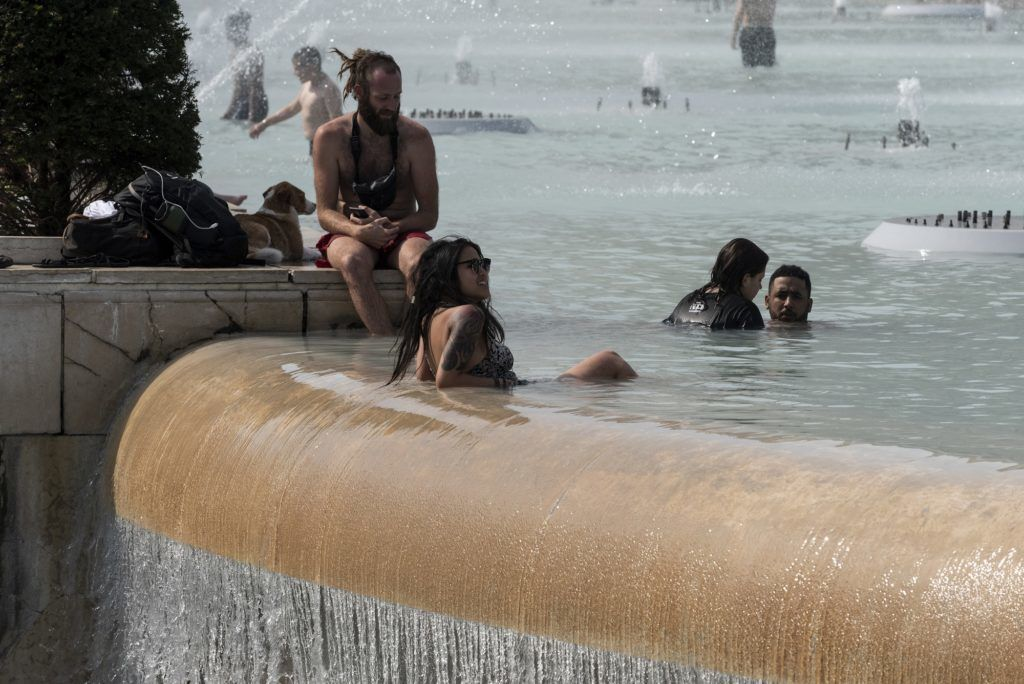 People in bathing suits swim in the Trocadero fountain on June 24, 2019, the first day of the heat wave, when an intense heat wave will hit all of France for a week and create a severe heat wave, potentially hotter than the one in 2003. (Photo by Samuel Boivin/NurPhoto)
